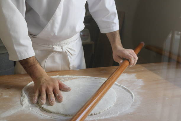 Using a rolling pin to make udon